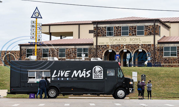 The Taco Bell taco truck sits in front of the historic Tomato Bowl in Jacksonville for the Taco Trot on Saturday. Saturday was the first time the truck had made its way to East Texas.