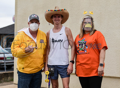 (From left) Jammin' Jimmy Olson of JJO Radio HD, first place Taco Trot 5K winner Joshua Jarvis of Tyler and event organizer Katrina Webb smile for a photo at the event hosted by Southern Multifoods, Inc. in downtown Jacksonville on Saturday.