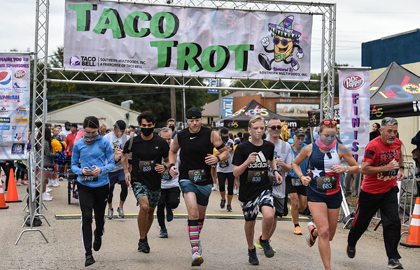 The first wave of runners takes off for the Taco Trot 5K in downtown Jacksonville on Saturday.