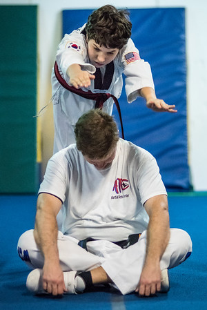 Making a spectacular entrance during Taekwondo practice.