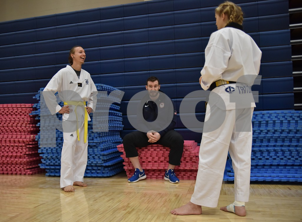 -Messenger photo by Britt Kudla<br /> Iowa Central's Nicholas Passehl and Paige Lehmkuhl chat with United State 2016 Taekwondo olympian Stephen Lambdin during Triton Taekwondo meet on Saturday at Hodges Field house