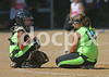 JOCO South catcher Karey Triplett (5) and pitcher Allie Stewart (12) confer during an injury timeout during the game with Roanoke Valley  in the U10 division of the Tar Heel League's State Softball Tournamnet. JOCO South lost to Roanoke Valley on Saturday before going to the loser's bracket and eventually losing out to Caldwell County.