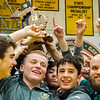 Record-Eagle/Brett A. Sommers Traverse City West raises its third consecutive wrestling district championship trophy Wednesday after West defeated Traverse City Central 43-29 and Alpena 51-19.