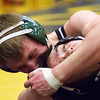 Record-Eagle/Brett A. Sommers Alpena's Emry Zarins nearly headlocks Traverse City West's Drew Daenzer during Wednesday's team district wrestling meet at Traverse City Central High School. West defeated Central 43-29 and Alpena 51-19 to win its third straight district title.