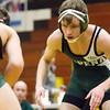 Record-Eagle/Brett A. Sommers Alpena's Keegan Harris readies to tangle with Traverse City West's Wylie Edick during Wednesday's team district wrestling meet at Traverse City Central High School. West defeated Central 43-29 and Alpena 51-19 to win its third straight district title.