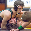 Record-Eagle/Brett A. Sommers Traverse City West's Jaxon Labreck (top) holds down Traverse City Central's Brandon Soloman during Wednesday's team district wrestling meet at Central High School. West defeated Central 43-29 and Alpena 51-19 to win its third straight district title.