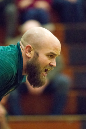 Record-Eagle/Brett A. Sommers Traverse City West head coach Rusty Nyland communicates instructions during Wednesday's team district wrestling meet at Central High School. West defeated Central 43-29 and Alpena 51-19 to win its third straight district title.