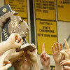 Record-Eagle/Brett A. Sommers Traverse City West raises its third consecutive district championship trophy Wednesday after West defeated Traverse City Central 43-29 and Alpena 51-19.