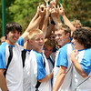 The Gate City High School Tennis team holds up their trophy after winning the Region D finals. Photo by Erica Yoon