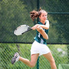 John Battle doubles player Carly Johnson hits back against Castlewood High School. Photo by Erica Yoon