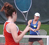 Wise Central's Jessica Power, in foreground wearing red, and Gate City's Taylor Evans in action during Region D girls Tennis doubles finals at UVA-Wise. Photo by Ned Jilton II