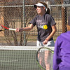 Evelyn Rogers of Dobyns Bennett hits shot during doubles match, Emily Smith of Gate City is in the foreground. Photo by Ned Jilton II