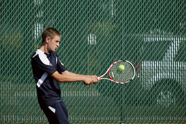 Record-Eagle/Keith King<br /> Traverse City St. Francis' Jack Krcmarik competes against Whitehall's Mike Miller at number four singles Thursday, October 6, 2011 at Traverse City Central High School.