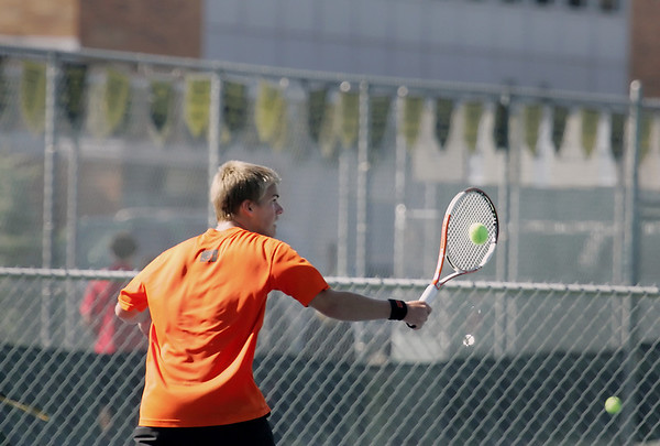 Record-Eagle/Keith King<br /> Elk Rapids' Josh Mosher competes against Ludington's Spencer Knudsen at number two singles Thursday, October 6, 2011 at Traverse City Central High School.