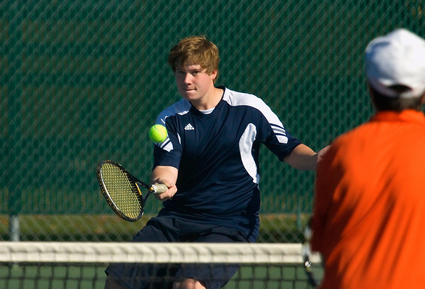 Record-Eagle/Keith King<br /> Traverse City St. Francis' Sean Leonhard returns a hit against Harbor Springs Thursday, October 6, 2011 during number one doubles play at Traverse City Central High School.