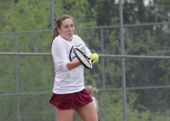 Record-Eagle/Keith King<br /> Charlevoix's Madi Carey hits the ball during number two singles competition against Traverse City St. Francis Monday, May 7, 2012 at Traverse City East Middle School.