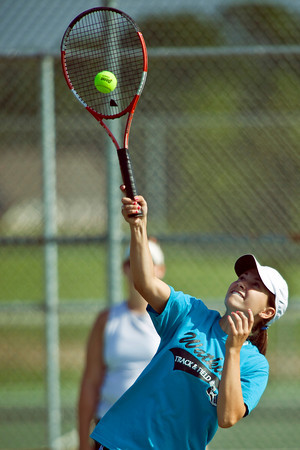 Senior Alana Cheplowitz returns a ball during Watkins Memorial High School Tennis Team practice held Thursday morning, August 13, 2009 at the high school on Watkins Road in Pataskala, Ohio. (Photo by James D. DeCamp 614-462-8027)