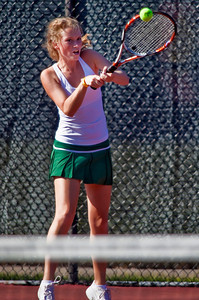 Dublin Coffman High School's Claire Immell in action while playing against Bexley High School's tennis team Wednesday afternoon September 2, 2009 at Dublin Coffman High School. (Photo by James D. DeCamp 614-462-8027)