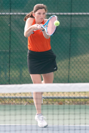 Senior Carly McAtee hits a forehand during the team sectionals against Springfield Central.