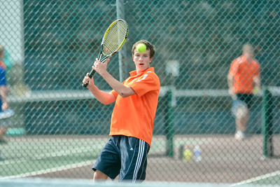 Danville's Nicholas Zotalis hits a shot toward his third singles opponet, South Williamsport's Mason McClain, during Monday's match.