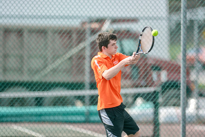 Danville's Aidan Kennedy hits a back hand during his first singles match against South Williamsport's McGwire Molino on Monday.