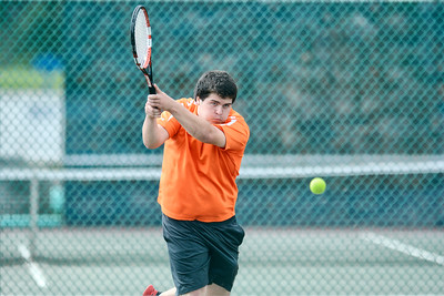 Danville's David Tuchman follows through on a back hand during his second singles match against South Williamsport's Bryce Brewer on Monday.