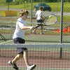 Brady Fries hits a backhand shot during his No. 3 singles match against Danville's Chris Zhang on Wednesday afternoon.
