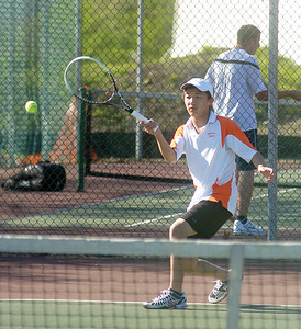 Danville's Steven Zhang returns a serve from Selinsgrove's Tyus Ludwig.