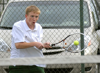Lewisburg's Peter Csernica returns the ball to Hughesville's Tyler Smith during their match Wednesday April 18, 2012.