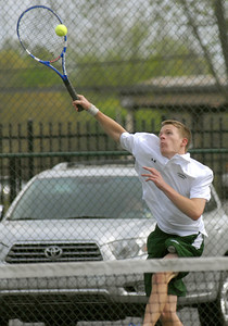 Lewisburg's Ben Coch reaches for a volley from Hughesville's Rilan Galicic during their match up Wednesday April 18, 2012.