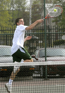 Lewisburg's Kerry Shutt returns a volley from Hughesville's Josh Fry during their match Wednesday April 18, 2012.