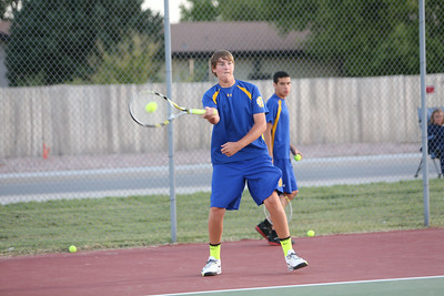 Gering's number two Alex Lupher in a singles match against Scottsbluff on Tuesday in Gering