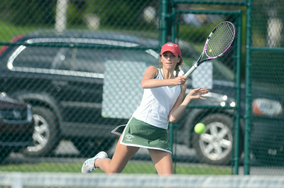 Lewisburg's Sydney Hartzel follows through on a forehand shot during her number one doubles match against Loyalsock on Monday.