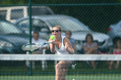 Lewisburg's Libby King hits a shot during her third singles match against Loyalsock.