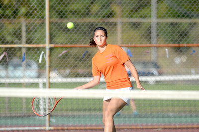 Danville's first singles player Kiona Robbins lines up her shot during her match on Monday against Shikellamy's Tiara Bartol.