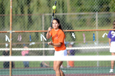 Danville's third singles player Christina Murphy follows through on a shot during her match Monday against Shikellamy's Emily Young.