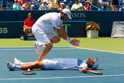 Mardy Fish of the USA celebrates over teammate Mark Knowles of the Bahamas after defeating Tomas Berdych of the Czech Republic and teammate Radek Stepanek of the Czech Republic during their doubles final on day 7 of the Legg Mason Tennis Classic at the William H.G. FitzGerald Tennis Center on August 8, 2010 in Washington, DC. Fish and Knowles won the match 4-6,7-6(10).  (Photo by Jeff Malet)