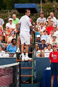 A mischievous Radek Stepanek climbs up the ladder to argue a call with the chair umpire during a match at the Legg Mason Tennis Classic in Washington DC on August 3, 2010. The Czech team of Stepanek and Tomas Berdych defeated top seed Canadian Daniel Nestor and Serbian Nenad Zimonjic in an early round of the tournament. (Photo by Jeff Malet)