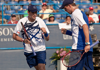 World record holders Mike and Bob Bryan celebrate a winning point against Rohan Bopanna and Aisam-ul-Haq Qureshi  in the quarterfinals of the Legg Mason Classic in Washington DC on August 6, 2010.The Indo-Pak pair Bopanna and Qureshi pulled off the biggest win of their career by upsetting the world number two Bryan Brothers who had recently surpassed Mark Woodforde and Todd Woodbridge's record of 61 career doubles tournament titles. (Photo by Jeff Malet)