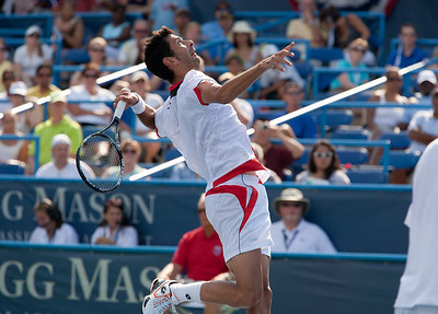 Austrian Julian Knowle hits a smash during a semi-final doubles match in Washington DC. Czech duo Radek Stepanek and Tomas Berdych moved into the doubles final of the Legg mason Tennis Classic after a come-from-behind win over fourth seeds Knowle and Israeli Andy Ram on August 7, 2010. (Photo by Jeff Malet)