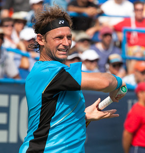 Argentina's injury-plagued David Nalbandian snapped a 19-month title drought by winning the Legg Mason Tennis Classic final Sunday, August 8 in Washington DC. Nalbandian beat eighth-seeded Marcos Baghdatis of Cyprus, 6-2, 7-6 (4), becoming the first player ranked outside the top 100 to win an ATP title this year. In addition to the $262,000 he collected for his 11th career title, Nalbandian is projected to surge 72 spots in the rankings-from 117 to 45. (Photo by Jeff Malet)