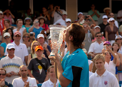 David Nalbandian of Argentina, ranked 117th, beat eighth-seeded Marcos Baghdatis of Cyprus, 6-2, 7-6 (4), in the Legg Mason Tennis Classic final Sunday in Washington, becoming the first player ranked outside the top 100 to win an ATP title this year. Here celebrating his victory.  In addition to the $262,000 he collected for his 11th career title, Nalbandian is projected to surge 72 spots in the rankings-from 117 to 45. August 8, 2010.  (Photo by Jeff Malet)