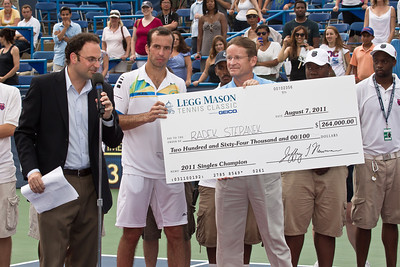 Radek Stepanek (second from left), of The Czech Republic, receives a check for $264,000 at the successful conclusion of his championship tennis match against Gael Monfils, of France, at the Legg Mason Tennis Classic, Sunday, Aug. 7, 2011, in Washington DC. The unseeded Stepanek upset the top seed Monfils in the finals in straight sets 6-4 6-4 for his fifth career ATP title. The match was played at the William H.G. Fitzgerald Tennis Center in Rock Creek Park on hard court. Stepanek at 32 became the oldest winner of the ATP Washington Classic since Jimmy Connors in1988. (Photo by Jeff Malet)