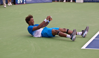 Gael Monfils, of France, takes a tumble during a championship match against Radek Stepanek, of The Czech Republic, at the Legg Mason Tennis Classic, Sunday, Aug. 7, 2011, in Washington DC. Monfils slid and stumbled while chasing a shot. He dropped his racket and stayed down on his back for a few seconds before checking his right elbow, then played on. The unseeded Stepanek upset the top seed Monfils in the finals in straight sets 6-4 6-4. The match was played at the William H.G. Fitzgerald Tennis Center in Rock Creek Park on hard court. (Photo by Jeff Malet)