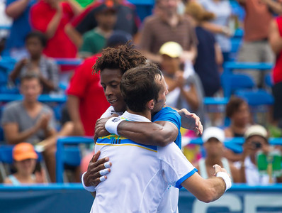 Gael Monfils (blue shirt), of France, hugs Radek Stepanek, of The Czech Republic, at the conclusion of the Legg Mason Tennis Classic, Sunday, Aug. 7, 2011, in Washington DC. The unseeded Stepanek upset the top seed Monfils in the finals in straight sets 6-4 6-4. The match was played at the William H.G. Fitzgerald Tennis Center in Rock Creek Park on hard court. (Photo by Jeff Malet)