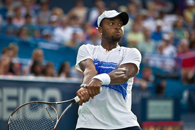 Donald Young (USA) returns the ball to Marcos Baghdatis, of Cyprus, during a tennis match at the Legg Mason Tennis Classic at the William H.G. FitzGerald Tennis Center in Rock Creek Park in Washington DC, Friday, August 5, 2011. The 22 year old Young won the quarterfinals match by the scores of 6-3, 7-6 (4). It was only Young's second quarterfinal on the top men's tennis circuit, and his first victory at that level. (Photo by Jeff Malet)
