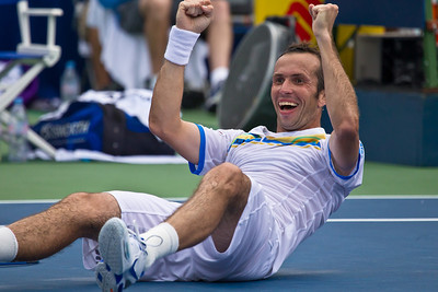 "Radek Stepanek, of The Czech Republic, celebrates a victory by doing ""the worm"" at the successful conclusion of his championship match against Gael Monfils, of France, at the Legg Mason Tennis Classic, Sunday, Aug. 7, 2011, in Washington DC. The unseeded Stepanek upset the top seed Monfils in the finals in straight sets 6-4 6-4. The match was played at the William H.G. Fitzgerald Tennis Center in Rock Creek Park on hard court. Stepanek earned a check for $264,000 for his fifth career title. Stepanek at 32 became the oldest winner of the ATP Washington Classic since Jimmy Connors in1988. (Photo by Jeff Malet)"