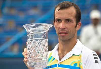 Radek Stepanek, of The Czech Republic, lifts trophy at the conclusion of his successful championship tennis match against Gael Monfils, of France, at the Legg Mason Tennis Classic, Sunday, Aug. 7, 2011, in Washington DC. The unseeded Stepanek upset the top seed Monfils in the finals in straight sets 6-4 6-4. The match was played at the William H.G. Fitzgerald Tennis Center in Rock Creek Park on hard court. Stepanek earned a check for $264,000 for his fifth career ATP title. Stepanek at 32 became the oldest winner of the ATP Washington Classic since Jimmy Connors in1988. (Photo by Jeff Malet)