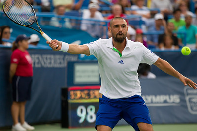 Marcos Baghdatis, of Cyprus returns the ball to Donald Young of the US, during a tennis match at the Legg Mason Tennis Classic at the William H.G. FitzGerald Tennis Center in Rock Creek Park in Washington DC, Friday, August 5, 2011. The 22 year old Young won the quarterfinals match by the scores of 6-3, 7-6 (4). It was only Young's second quarterfinal on the top men's tennis circuit, and his first victory at that level. (Photo by Jeff Malet)