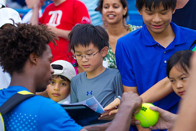 Gael Monfils, of France,signs autographs for fans at the conclusion of the Legg Mason Tennis Classic, Sunday, Aug. 7, 2011, in Washington DC. The unseeded Radek Stepanek upset the top seed Monfils in the finals in straight sets 6-4 6-4. The match was played at the William H.G. Fitzgerald Tennis Center in Rock Creek Park on hard court. (Photo by Jeff Malet)